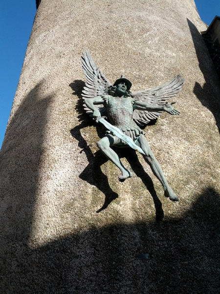 Sculpture of St Michael on the historic spire of St Michael in Lewes